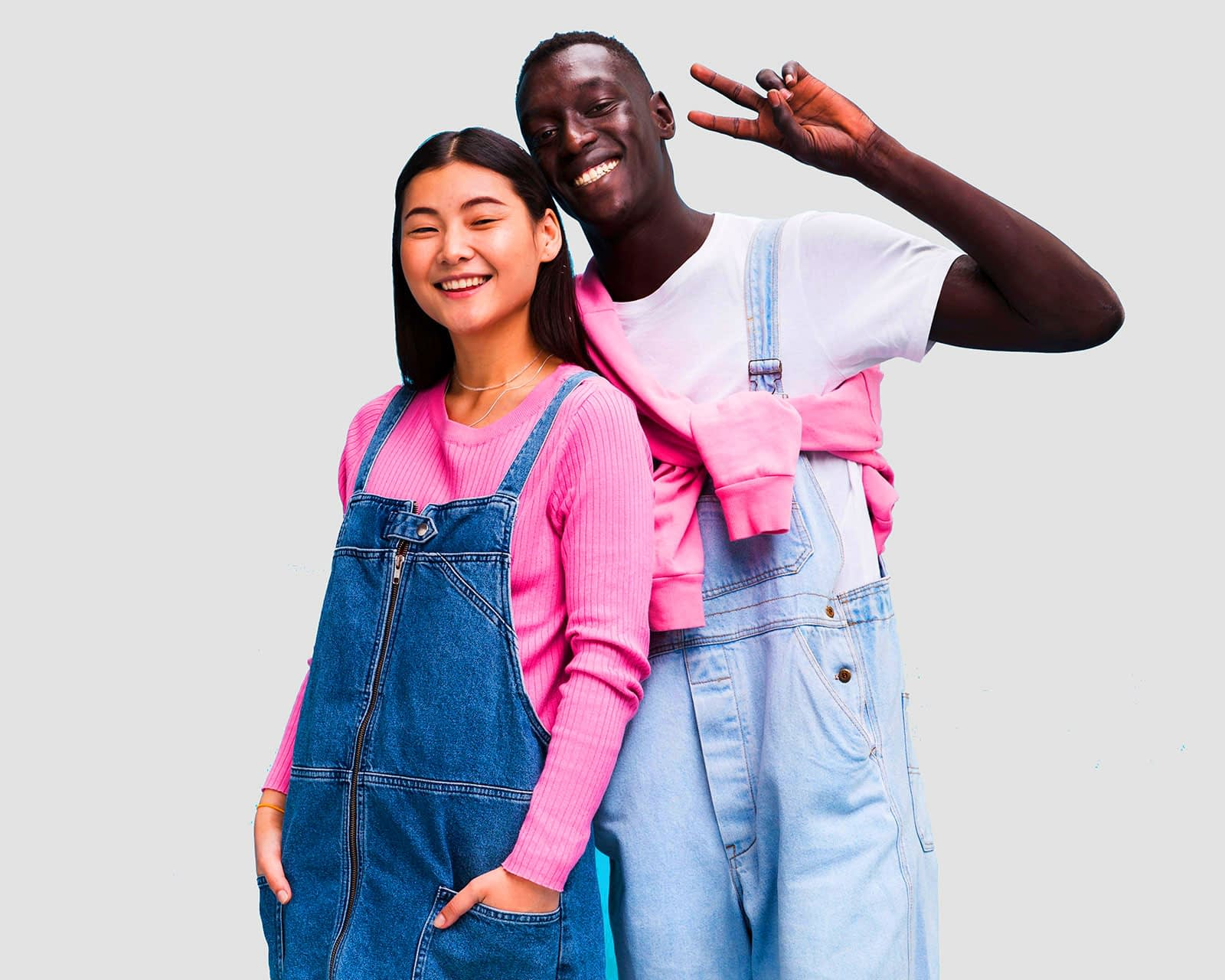 Happy interracial couple embracing and posing happily together.